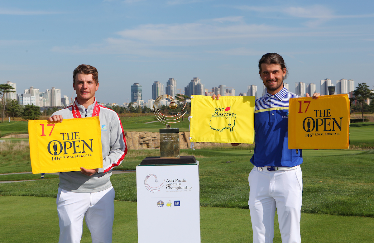 Incheon, South Korea: Brett Coletta(left,runner-up) and Curtis Luck (right, champion) of the 2016 Asia-Pacific Amateur Championship holding The Open and the Masters flags next to the AAC Trophy at the Jack Nicklaus Golf Club in Korea on October 9th, 2016. (Photo by AAC)